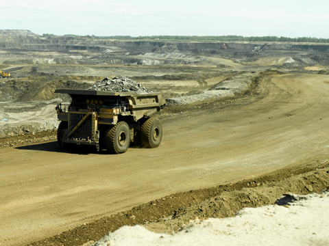 Dumper truck on tar sands road