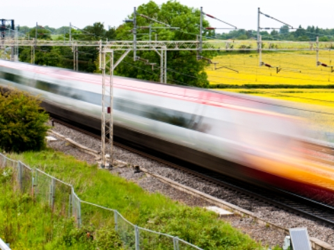 High speed train speeding by in a blur