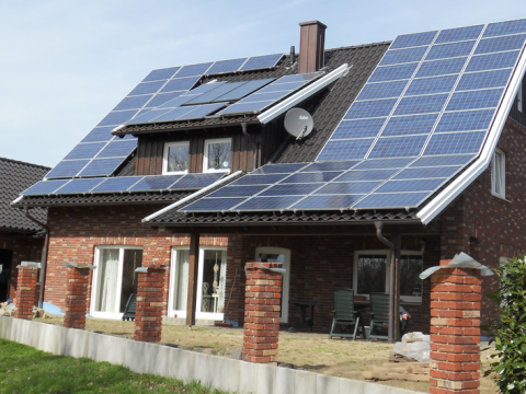 Solar is everywhere in Germany. This is a newly constructed home with near total solar covering. Photo: Tim Fuller via Flickr.com.