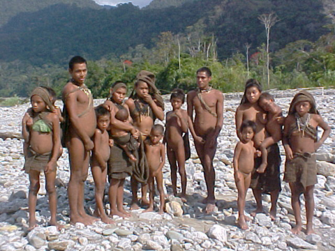 Nanti people on river bank. Photo: © Anonymous / Survival.