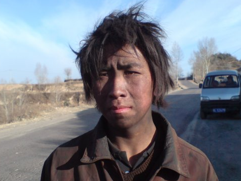 A happy future for coal? Young coal worker in Linfen, Shanxi, China. Photo: andi808 via Flickr.com.