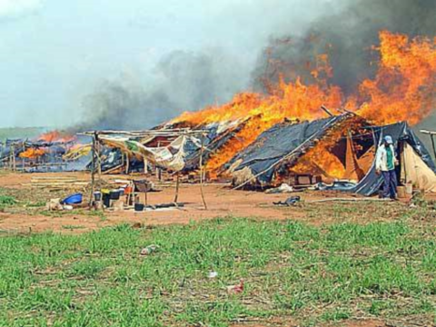 An encampment in of rural people evicted by soy barons is bunt out, Paraguay.