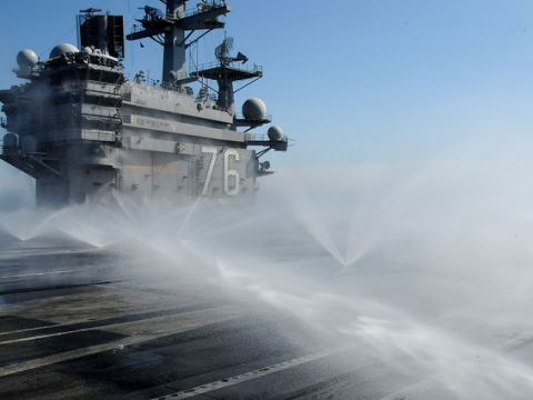 March 23, 2011 - The aircraft carrier USS Ronald Reagan conducts a wash down while the ship is operating off the coast of Japan, to remove potential radiation contamination. U.S. Navy photo by Mass Communication Specialist 3rd Class Kyle Carlstrom.