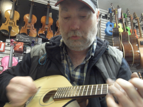 Brian Nicholson runs the islands' mandolin, ukulele and guitar shop. Photo: Thembi Mutch.