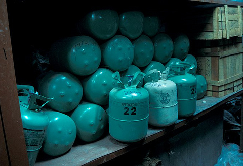 A seizure of canisters of CFCs and HCFCs labelled as CFC-12 and CFC-22. Photo: EIA.