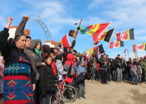 Lakota members marched during the annual Liberation Day commemoration of the Wounded Knee massacre. Photo: Deep Roots United Front / Victor Puertas.