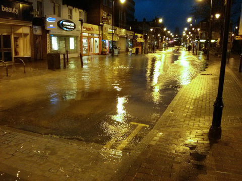 Going to waste ... a burst water main in Wealdstone, Harrow, 7th Feb 2014. Photo: timku via Flickr.com.