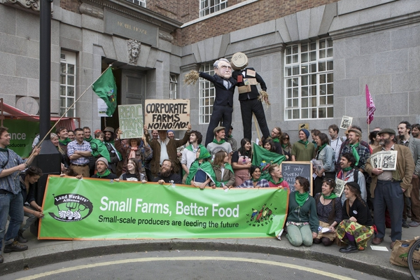 Over 100 people set up a farmers' market stall outside DEFRA offices to denounce Owen Paterson's marginalisation of small farms. Photo: Adrian Arbib.