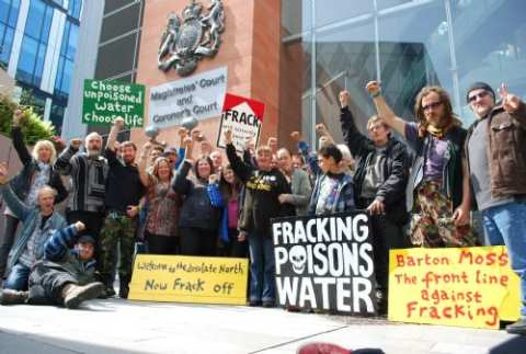 Barton Moss anti-fracking protestors outside Manchester Court, where cases have recently collapsed against five protestors. Photo: Climate James / SalfordStar.com.