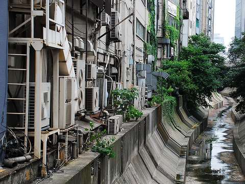 These air conditioners in Shibuya, near Tokyo, are only adding to summer temperatures. Photo: Amir Jina via Flickr.