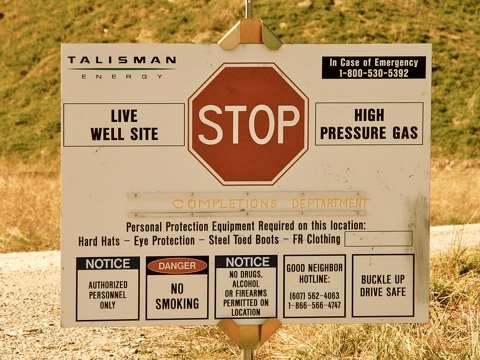 Mixed messages: a warning sign at a fracking site in Pennsylvania. Photo: Ostroff Law / Wikimedia Commons.