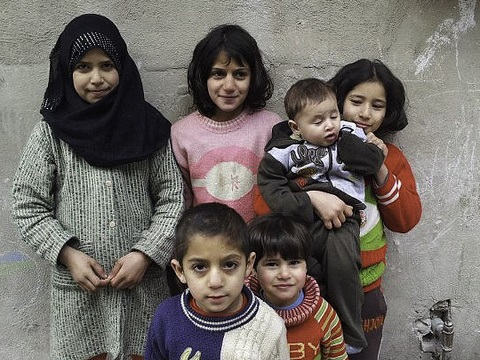 Even if they survive the war, these children in Homs face a toxic future for many years to come from the release of industrial toxins and residues from munitions, propellants and explosives. Photo: Freedom House via Flickr.