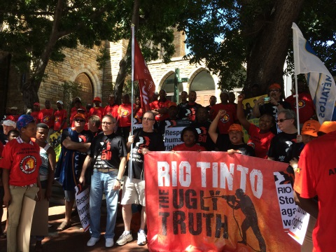 Unionists protest at RT's labour practices in Cape Town, South Africa, February 2014. Photo: IndustriALL.