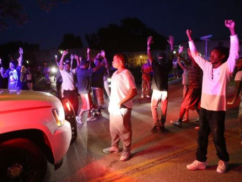 Ferguson - Hands Up Don't Shoot! Photo: via PFLP.