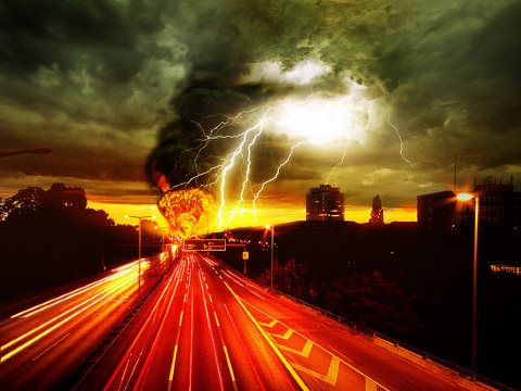 The road to hell - that's where we are heading if we do not act on climate. Photomontage: Andreas Levers via Flickr.  A115 Autobahn by Andreas Levers. Lightning by ~Prescott. Cloud lightning by Kristiewells. Fire and smoke by Jason Gillyon.