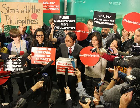 The world stood with Yeb Sano and the Philippines in 2013 - but now the Philippines are dumping him and the principled policies he represented. Photo: Handing over 600k solidarity messages to Yeb Sano at the Warsaw COP, by Push Europe (CC BT-NC 2.0).