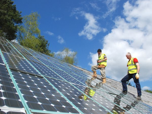 Thanks to the increasing role of solar power, electricity could soon be 'free' - at least while the sun is shining. Solar panels under installation at the Centre for Alternative Technology. Photo: CAT via Flickr (CC BY 2.0).