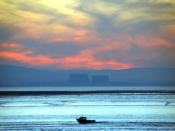 Sunset over Hinkley Point. Photo: Joe Dunckley via Flickr (CC BY-NC-SA 2.0).