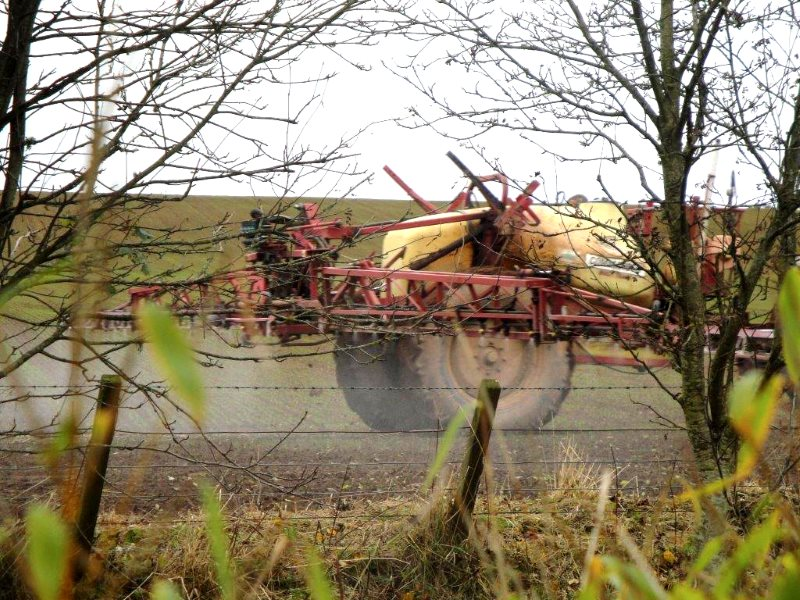 Agrochemicals are routinely sprayed right up to the boundary line with residential properties, causing severe ill-health to rural residents. Photo: UK Pesticides Campaign.