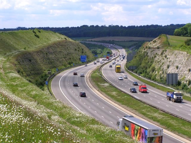 The notorious M3 motorway cutting through Twyford Down, near Winchester, which gave birth to the modern road protest movement. Photo: Jim Champion / geograph.org.uk via Wikimedia Commons (CC BY-SA).