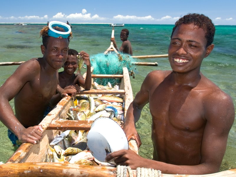 Young fishers with their catch on the opening day after a temporary fisheries closure. Small-scale fisheries support the livelihoods of at least 500 million people worldwide - Andavadoaka, Madagascar. Photo: Garth Cripps / Blue Ventures.