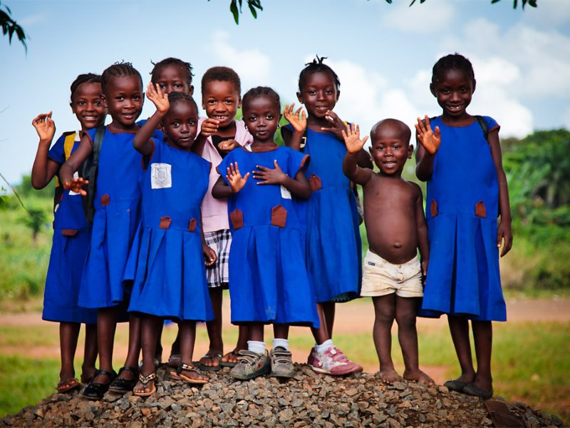 If you want to improve education for the poor, like these school children in Sierra Leone, handing over hundreds of millions of pounds to global corporations is not the way to do it. Photo: bobthemagicdragon via Flickr (CC BY-NC-ND).