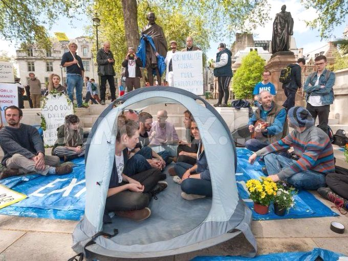 Donnachadh McCarthy is among those engaged in a peaceful 'sit in' protest in Parliament Square on Monday 4th of May at the foot of Mahatma Ghandi's statue, prior to his arrest. Photo: via Facebook.