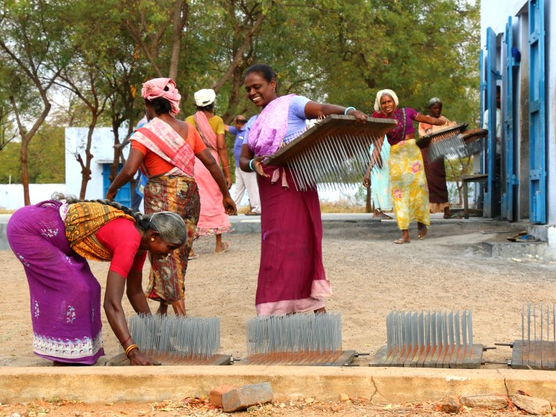 Women in India preparing to dry their farm produce using Sunbest equipment. Photo: Ashden.