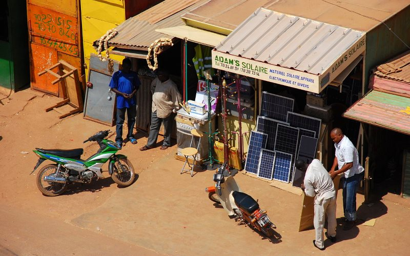 The small scale solar sector is also taking off around the tropics, as at this shop for solar cell panels in Ouagadougou, Burkina Faso. Photo: Wegmann via Wikimedia Commons (CC BY-SA).