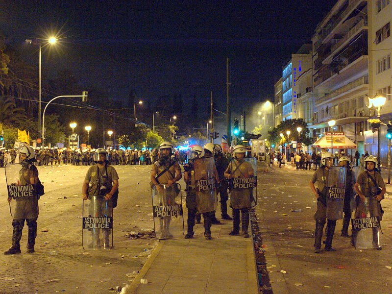 The real battle is only just beginning. Riot police in Syntagma late in the night after large demonstration of 'Indignados', in Syntagma Square, Athens, Greece, 29th June 2011. Photo: Ggia via Wikimedia Commons (CC BY-SA).