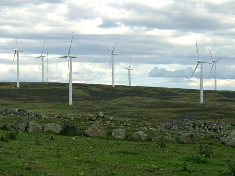 The answer, my friend, is blowing in the wind. Cairn Gleamnach in the foreground, Drumderg wind farm behind. Photo: Stuart Anthony via Flickr (CC BY-NC-ND).