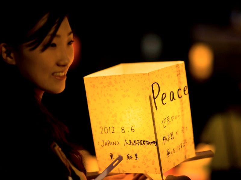 A young woman participates in Hiroshima's lantern floating ceremony on the Motoyasu River that runs below the Atomic Bomb Dome, 6th August 2012. Photo: Freedom II Andres via Flickr (CC BY).