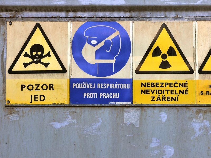 Radioactive warning signs at a Czech processing plant storage facility where 'yellowcake' uranium ore is processed. Photo: IAEA Imagebank via Flickr (CC BY-SA).