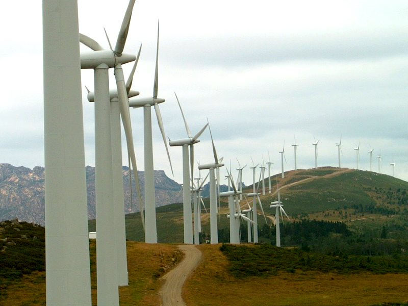 Wind turbines along a mountain ridge in Galicia, Spain. Photo: Luis Alves via Flickr (CC BY).