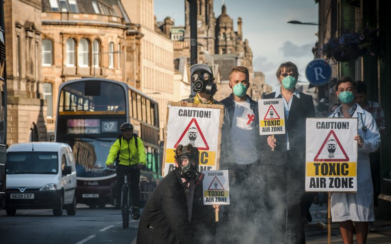 Campaigners from Friends of the Earth Scotland gather on Nicolson Street, Edinburgh on 25th August 2015 to demand clean air after the zone failed to meet Scottish Air Quality Safety Standards. Photo: Friends of the Earth Scotland via Flickr (CC BY).