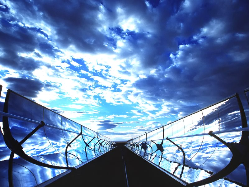 Parabolic Trough Collectors in New Mexico, USA. They work by concentrating the sun's rays on an oil-filled tube running along the focal line of the trough. Photo: Randy Montoya / Sandia Labs via Flickr (CC BY-NC-ND).