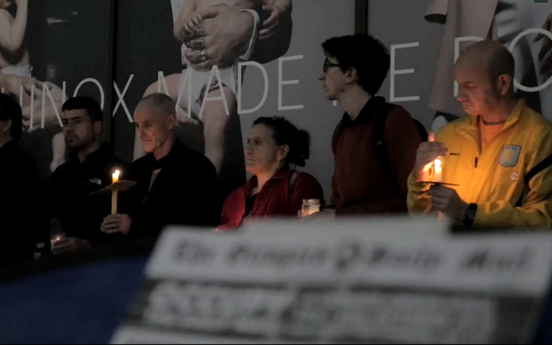 Candlelit vigil outside the Daily Mail offices in London to commemorate the estimated half million people dying every year as a result of climate change. Photo: Still from video by IndyRikki media.