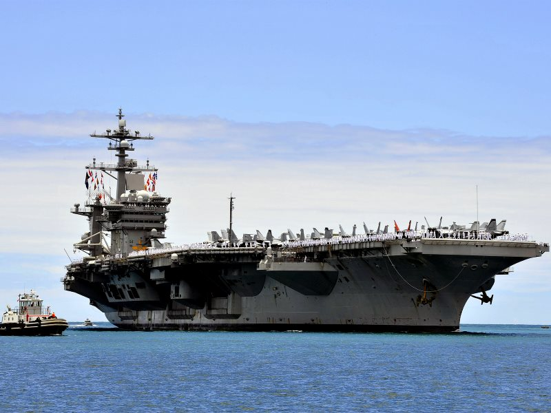 US Pacific Fleet aircraft carrier USS Carl Vinson arrives at Joint Base Pearl Harbor-Hickam for a port visit while in transit to its homeport of San Diego. US Navy photo by Mass Communication Specialist 2nd Class Jeff Troutman via Flickr (CC BY-NC).
