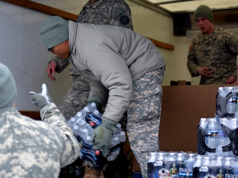 The Flint Water Response Team hard at work distributing bottled water to Flint residents. Photo: Michigan State Police Emergency Management and Homeland Security Division via Flickr (CC BY-ND).