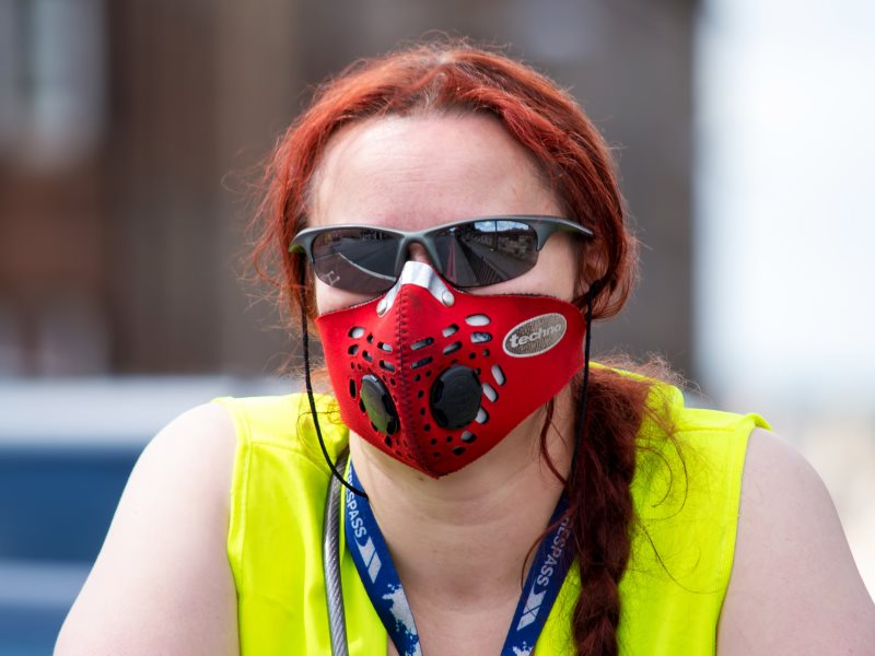 Cyclist wearing face mask to protect against polluted air. Photo: Hamish Irvine via Flickr (CC BY-NC).