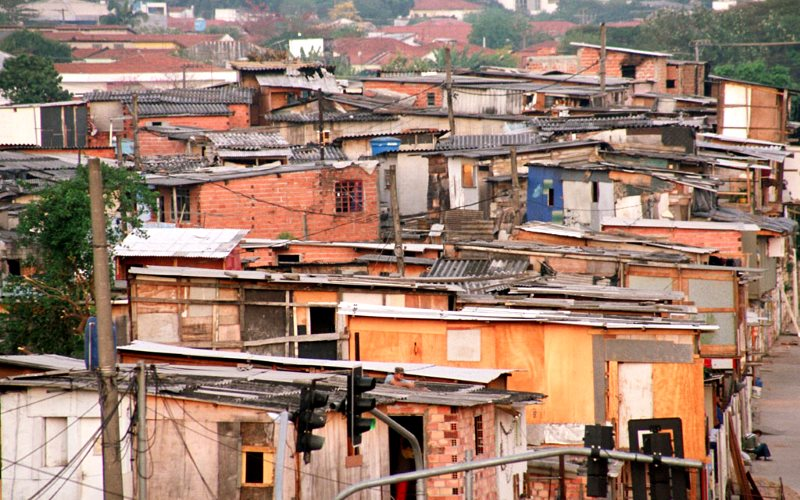 The densely conditions in Brazil's 'favelas', like this one in São Paulo, and the need for water tanks and containers, create idea conditions for Aedes mosquitos. And as the world warms, the mosquitos' range is expanding. Photo: Fernando Stankuns via Fli
