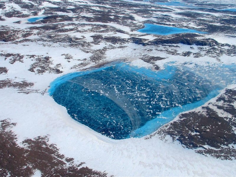 Frozen meltwater lake along the northeast Greenland coast, as seen from NASA's P-3B aircraft on May 7, 2012. Photo: Jim Yungel / NASA Goddard Space Flight Center via Flickr (CC BY).