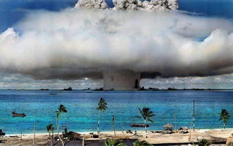 A US nuclear weapon is detonated at Bikini Atoll in the Marshall Islands in 1946. (Image has been colorized.) Photo: US Government via International Campaign to Abolish Nuclear Weapons on Flickr (Public Domain).