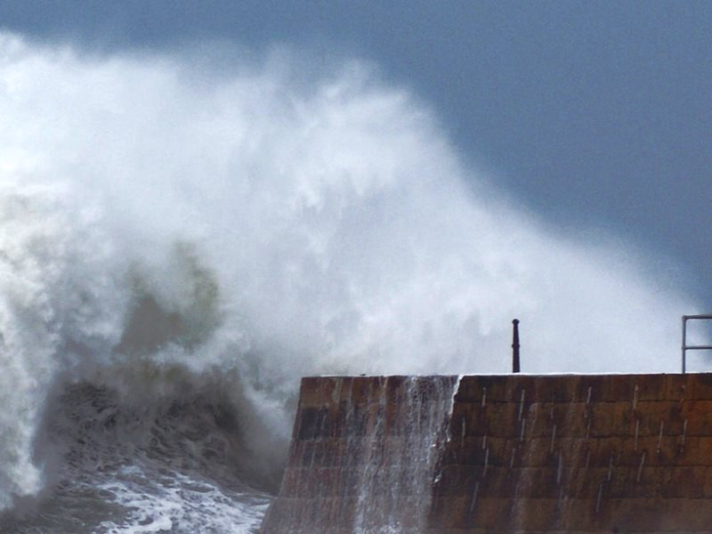 Raging seas: storm waves bear down on the already damaged Porthreath harbour wall, 1st February 2014. Photo: Philip Male via Flickr (CC BY).