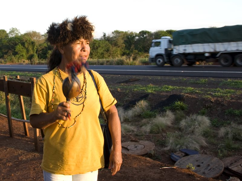 A Guarani woman at the roadside. Photo: Survival International.