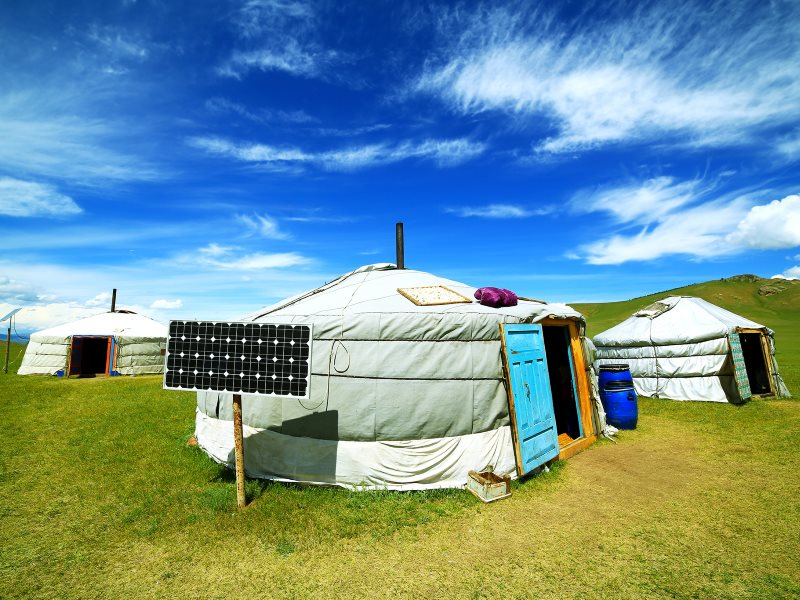 These yurts on Mongolia's 'sea of grass' are powered through a miniature solar microgrid that is both compact and lightweight for easy carriage on to the next site. Photo: Shutterstock.