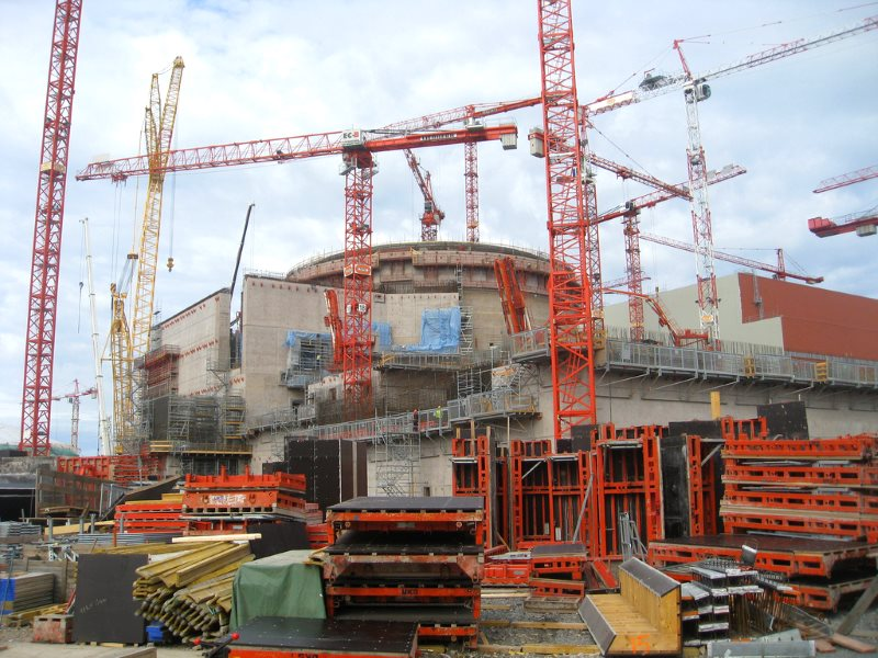 The disastrous Okiluoto 3 EPR reactor under construction in Finland. The project is taking twice as long to complete, and costing twice as much, as promised. Photo: BBC World Service via Flickr (CC BY-NC).