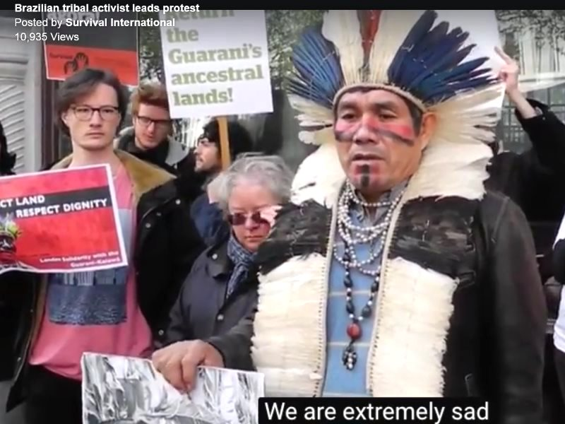 Guarani tribal leader and activist Ladio Veron speaking outside the Brazilian Embassy in London, in an action replicated across the globe. Photo: still from Survival video.