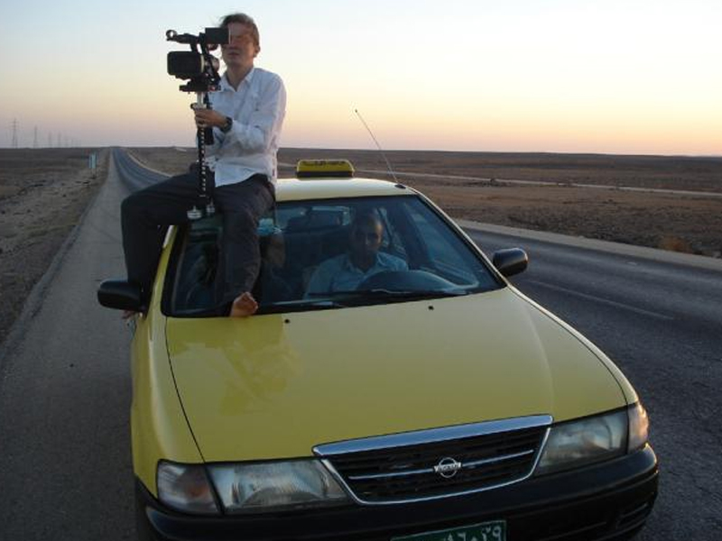 Director Franny Armstrong filming on top of a taxi