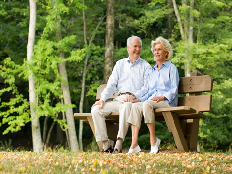 An old couple on a park bench